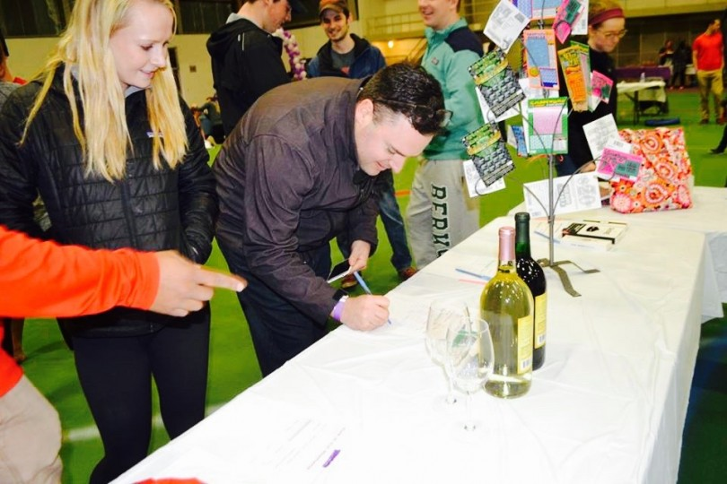 Community members participate in an on-site silent auction