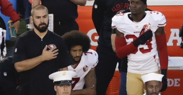 San Francisco 49ers quarterback Colin Kaepernick, middle, kneels during the national anthem before the team's NFL preseason football game against the San Diego Chargers, Thursday, Sept. 1, 2016, in San Diego. (AP Photo/Chris Carlson) ORG XMIT: CACC108