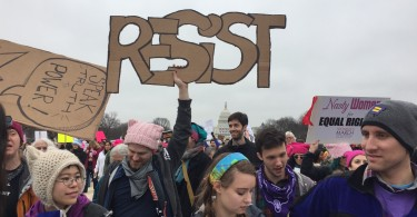 "The ""Resist"" sign with the Capitol building in the back was such a powerful image while marching on the National Mall. I couldn't help but look back while marching to take in the scene. (Photo Sydney Fallone '17/Managing Editor)"
