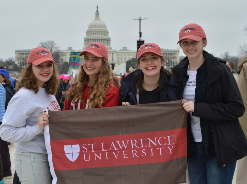 First year students Kiersten Larrabee '20, Sydney White '20, Kate Angus '20 and Emily Keenan '20 gathered to represent St. Lawrence in front of the Capital and show solidarity in their scarlet and brown. (Photo Beth Larabee/Guest Photographer)