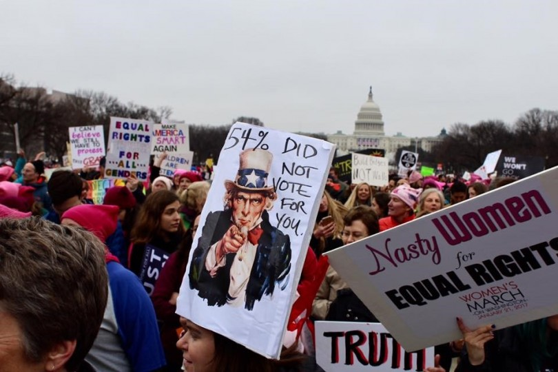 Protestors criticized the fact that President Trump did not earn the popular vote, a stark objection to his inauguration which occurred just 24 hours earlier on the steps of the Capital in the background. (Photo Olivia White '17/Editor in Chief)