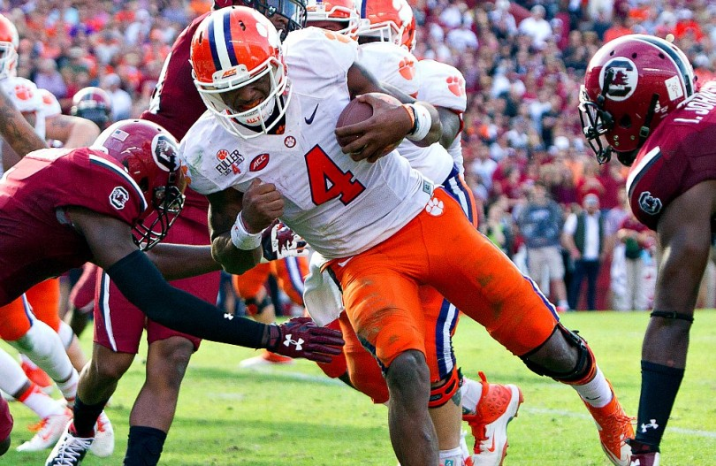 Nov 28, 2015; Columbia, SC, USA;  Clemson Tigers quarterback Deshaun Watson (4) carries for a touchdown during the second half against the South Carolina Gamecocks at Williams-Brice Stadium. Mandatory Credit: Joshua S. Kelly-USA TODAY Sports