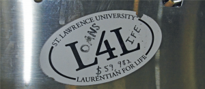 "A ""Laurentian for Life"" sticker altered to promote the phrase ""Loans for Life,"" protesting the increase in the comprehensive fee from 2014, for the '14-'15 school year."